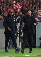 Atletico de madrid's team member German 'El mono' Burgos; Atletico Madrid's Argentinian coach Diego Simeone