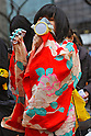 Tokyo, Japan - March 11: A woman in Kimono, a Japanese traditional clothes, and with a mask participated in a demonstration against nuclear power plants at Chiyoda, Tokyo, Japan on March 11, 2012. As this day was one year anniversary of Great East Japan Earthquake and Tsunami, there were many demonstrations held in the city.