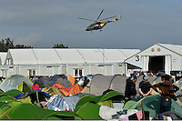 Pictured: A military helicopter flies over the camp Tuesday 01 March 2016<br /> Re: Thousands of migrants, still stranded at the Greek FYRO Macedonian border in Idomeni, Greece