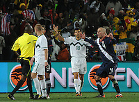 Michael Bradley protests the mysteriously disallowed late goal, which would have given the U.S. a 3-2, come-from-behind win. The United States came from a 2-0 halftime deficit to Slovenia to earn a 2-2 draw their second match of play in Group C of the 2010 FIFA World Cup.