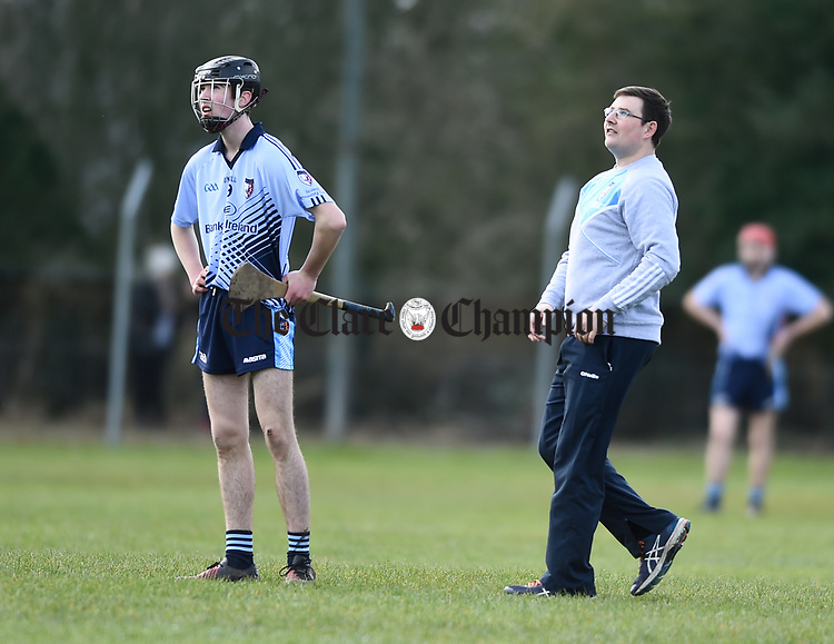 Ronan Hayes and mentor Jimmy Meagher of Scariff Community College watch a free go over against St Fergal's College during their All-Ireland Colleges final at Toomevara. Photograph by John Kelly.