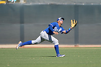 Kansas City Royals outfielder Samir Duenez (34) makes a diving catch during an instructional league game against the Seattle Mariners on October 2, 2013 at Surprise Stadium Training Complex in Surprise, Arizona.  (Mike Janes/Four Seam Images)