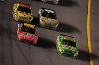 Jul. 5, 2008; Daytona Beach, FL, USA; NASCAR Sprint Cup Series driver Kyle Busch (18) leads Jeff Gordon (24) Carl Edwards (99) and Matt Kenseth (17) during the Coke Zero 400 at Daytona International Speedway. Mandatory Credit: Mark J. Rebilas-
