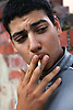 Youth smoking a cigarette,