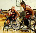MARSHALL, MN - MARCH 15:  Abby Farrell #20 from Illinois looks to make a move against Katherine Lang #32 from Alabama at the 2018 National Intercollegiate Wheelchair Basketball Tournament at Southwest Minnesota State University in Marshall, MN. (Photo by Dave Eggen/Inertia)