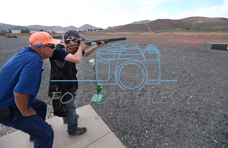 Coach Rusty Wolbers works with Robert Lamkin, 13, during practice at the Capital City Gun Club, in Carson City, Nev., on Friday, July 11, 2014.<br />