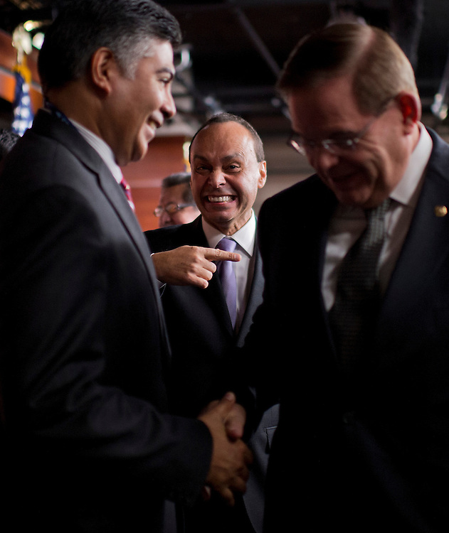"UNITED STATES - NOVEMBER 28:  From left, Rep.-elect Tony Cardenas, D-Calif., Rep. Luis Gutierrez, D-Ill., and Sen. Bob Menendez, D-N.J., leave a news conference in the Capitol Visitor Center held by the Congressional Hispanic Caucus entitled ""One Nation: Principles on Immigration Reform and Our Commitment to the American Dream.""  (Photo By Tom Williams/CQ Roll Call)"