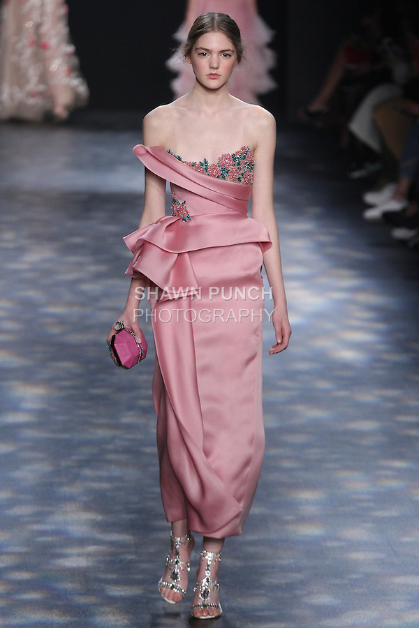 Model Madison walks runway in a strapless cocktail in rose satin-faced organza with hand-draped bodice, sculptural peplum, exposed corset and 3D encrusted floral embroidery, from the Marchesa Fall 2016 collection by Georgina Chapman and Keren Craig, presented at NYFW: The Shows Fall 2016, during New York Fashion Week Fall 2016.