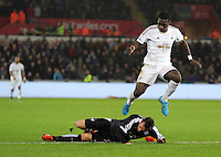 Bafetimbi Gomis of Swansea is stopped by Christian Fuchs of Leicester City during the Barclays Premier League match between Swansea City and Leicester City at the Liberty Stadium, Swansea on December 05 2015