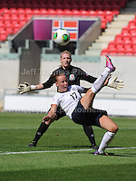 Bethany Mead of England battles with goalkeeper Alice Evans of Wales during the UEFA Womens U19 Championships at Parc y Scarlets, Monday 19th August 2013. All images are the copyright of Jeff Thomas Photography-www.jaypics.photoshelter.com-07837 386244-Any use of images must be authorised by the copyright owner.