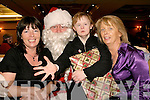 annual christmas party for Eagle lodge, Oakpark, Tralee last Sunday afternoon in the Meadowlands Hotel Tralee, Aileen (Carmody) Switzer, Santa, Maura Carmody and Joanne (Carmody) O'Mahony.   Copyright Kerry's Eye 2008