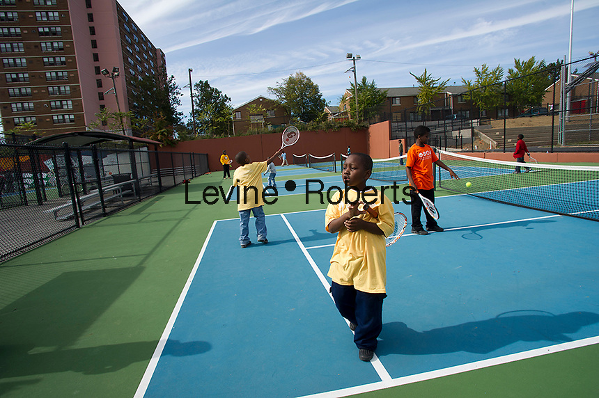 Kids on the tennis courts.  Jesse Allen Park Phase II Opening Celebration, Newark, NJ on Wednesday, October 17, 2012. KIDS IN TPL T SHIRTS ARE MODEL RELEASED.  (© Frances M. Roberts)