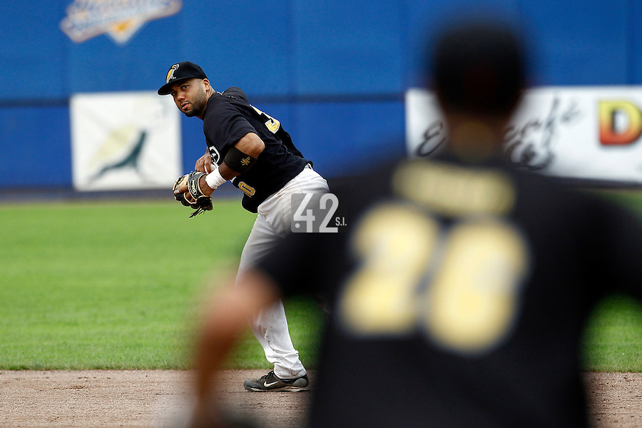 10 September 2011: Vince Rooi of L&D Amsterdam Pirates throws the ball to first base during game 4 of the 2011 Holland Series won 6-2 by L&D Amsterdam Pirates over Vaessen Pioniers, in Amsterdam, Netherlands.