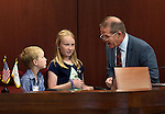 Nevada Lt. Gov. Mark Hutchison talks with Jack and Julianne Delap on the Senate floor at the Legislative Building in Carson City, Nev., on Thursday, May 7, 2015.<br /> Photo by Cathleen Allison