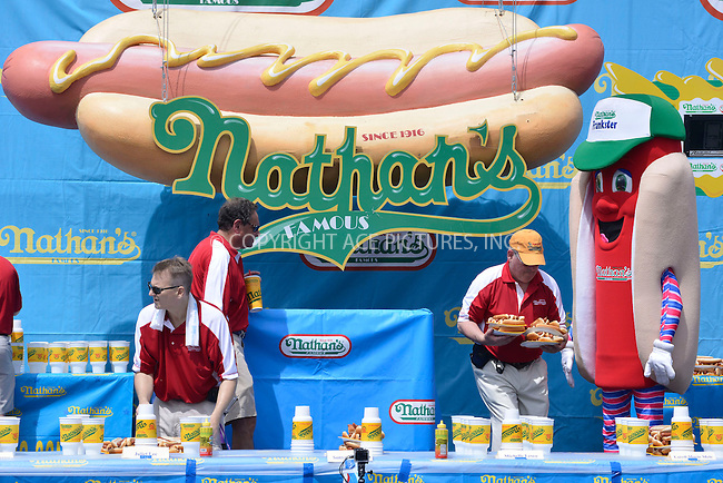 WWW.ACEPIXS.COM . . . . . <br /> July 4, 2013...New York City....Nathan's Hotdog Eating Contest in Coney Island on  July 4, 2013 in New York City. ....Please byline: CURTIS MEANS - WWW.ACEPIXS.COM.. . . . . . ..Ace Pictures, Inc: ..tel: (212) 243 8787 or (646) 769 0430..e-mail: info@acepixs.com..web: http://www.acepixs.com