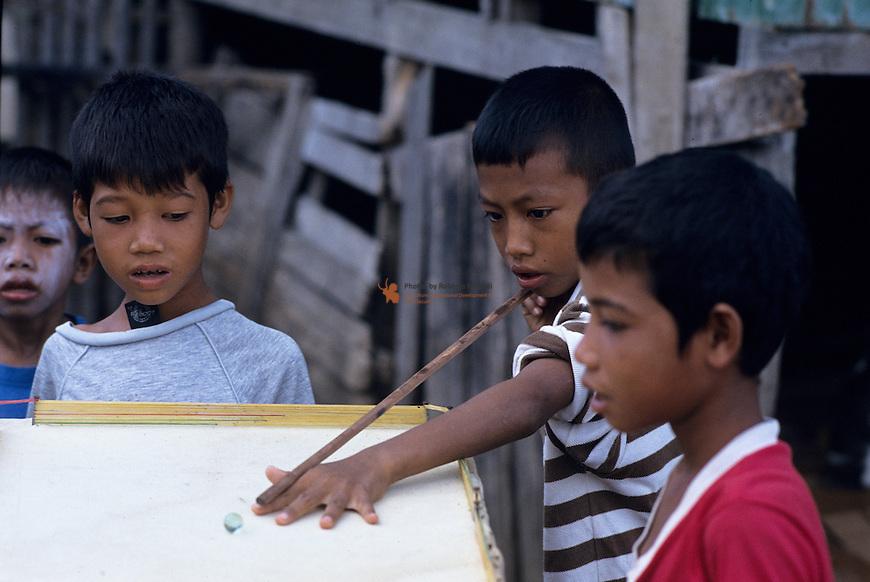 Boys playing with a homemade biliardo