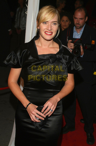"KATE WINSLET.At ""All The Kings Men"" Press Premiere during the 2006 Toronto International Film Festival held at Roy Thomson Hall, Toronto, Ontario, Canada,10 September 2006..half length black satin dress bow collar clutch bag.Ref: ADM/BP.www.capitalpictures.com.sales@capitalpictures.com.©Brent Perniac/AdMedia/Capital Pictures."