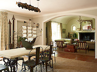 The open-plan living and dining area is divided by a generous arched doorway