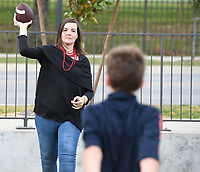 NWA Democrat-Gazette/J.T. WAMPLER  Auburn fans Ashlee Switzer of Nashville Tenn. plays catch with her son John Switzer Saturday Oct. 21, 2017 before the Arkansas Auburn football game.