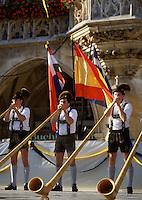 Traditional alpenhorn band musicians in leiderhosen play during Oktoberfest celebrations. Munich, Germany.