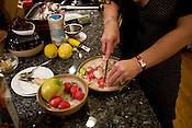 The author, Jayne Snyder, prepares radishes to add to butternut squash soup.