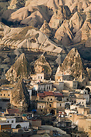 Goreme, Cappadocia, Nevsehir, Turkey, December 2009. Flying over the village of Goreme in the rocks. Hot air ballooning is the number one activity in Capadocia. The fairy landscape of Goreme National Park is unique in its kind. Millions of years long, wind and water sculpted the tuffstone into spectacular rock formations.  Photo by Frits Meyst / MeystPhoto.com