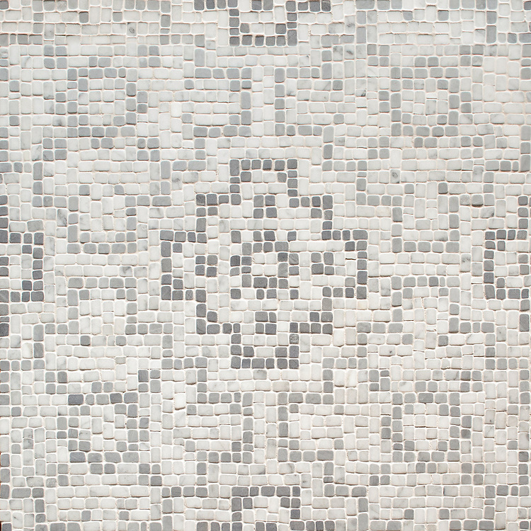 Bahir, a hand-chopped stone mosaic, shown in tumbled Carrara, light Bardiglio and medium Bardiglio, was designed by Sara Baldwin as part of the Legend collection by New Ravenna.