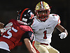 Justin Brown #1 of Half Hollow Hills West rushes for a gain as Joe Yarusso #5 of Plainedge closes in on him during the first quarter of the Class III Long Island Championship at Shuart Stadium in Hempstead on Saturday, Nov. 24, 2018.