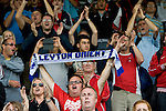 Stevenage 0 Leyton Orient 1, 17/08/2013. Broadhall Way, League One. Leyton Orient arrived in Stevenage with the swagger of a club that had started the season well, while Stevenage searched for their first point. Leyton Orient supporters celebrate their 1-0 win. Photo by Simon Gill
