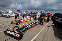 Aug 31, 2014; Clermont, IN, USA; The cars of NHRA top fuel dragster drivers (near to far) Billy Torrence , Doug Kalitta and Morgan Lucas in the staging lanes during qualifying for the US Nationals at Lucas Oil Raceway. Mandatory Credit: Mark J. Rebilas-USA TODAY Sports