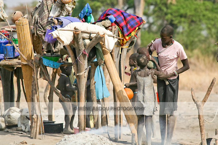Traditionally nomadic, a Dinka family lives in  a cattle camp near Rumbek, South Sudan.