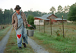 John Lloyd, 86, walks home after collecting eggs at his Chapel Hill Farm in 1999.  Lloyd died in 2001, and the land adjacent to his farm was soon occupied by Meadowmont, a 435-acre commercial and residential development.
