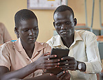 An instructor helps a student use a tablet computer in the Loreto School outside Rumbek, South Sudan. The school is run by the Institute for the Blessed Virgin Mary--the Loreto Sisters--of Ireland.