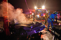 Rincon Valley and Rancho Adobe firefighters respond the scene of an accident involving a single vehicle that struck a telephone pole and caught fire on Wilfred Avenue, near the intersection of Sunland Avenue, west of Rohnert Park, Calif., on November 29, 2013. (Alvin Jornada / The Press Democrat)