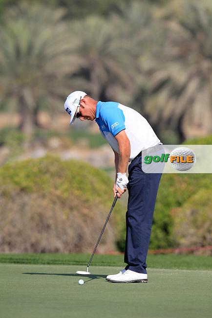 Mikko Ilonen (FIN) takes his putt on the 1st green during Friday's Round 2 of the Abu Dhabi HSBC Golf Championship 2015 held at the Abu Dhabi Golf Course, United Arab Emirates. 16th January 2015.<br /> Picture: Eoin Clarke www.golffile.ie