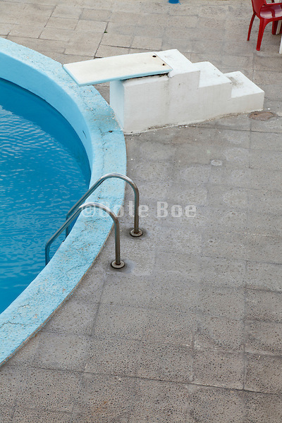 edge of a swimming pool early morning before guests arrive
