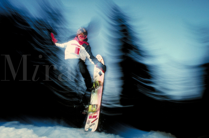 Man snowboarding, Summit County, CO; blurred motion. Summit County, Colorado.