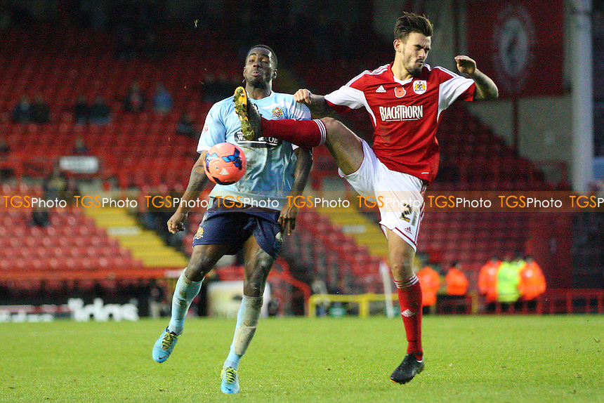 Abu Ogogo of Dagenham and Redbridge and Marlon Pack of Bristol City -  Bristol City vs Dagenham and Redbridge at the Ashton Gate Stadium - 09/11/13 - MANDATORY CREDIT: Dave Simpson/TGSPHOTO - Self billing applies where appropriate - 0845 094 6026 - contact@tgsphoto.co.uk - NO UNPAID USE