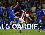 Lee Tomlin of Cardiff City tussles with Paul Coutts of Sheffield Utd during the Championship match at the Cardiff City Stadium, Cardiff. Picture date: August 15th 2017. Picture credit should read: Simon Bellis/Sportimage