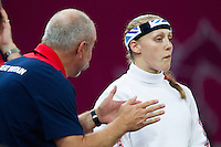 12 AUG 2012 - LONDON, GBR - Mhairi Spence (GBR) (right) of Great Britain listens to coach Istvan Nemeth as she waits for her next match during the women's London 2012 Olympic Games Modern Pentathlon fencing at The Copper Box in the Olympic Park, in Stratford, London, Great Britain (PHOTO (C) 2012 NIGEL FARROW)