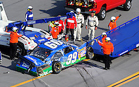 Apr 26, 2009; Talladega, AL, USA; The car driven by NASCAR Sprint Cup Series driver Carl Edwards is moved off the track after a last lap crash in the Aarons 499 at Talladega Superspeedway. Mandatory Credit: Mark J. Rebilas-