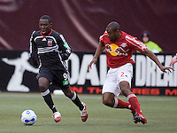 DC United's (9) Freddy Adu is marked by Red Bulls (2) Marvell Wynne during the 1st half. DC United defeated the Red Bulls 4-1 at Giant's Stadium, East Rutherford, NJ, on April 22, 2006.