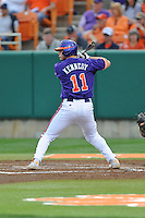 Clemson Tigers first baseman Shane Kennedy #11 awaits a pitch during a game against the Florida State Seminoles at Doug Kingsmore Stadium on March 22, 2014 in Clemson, South Carolina. The Seminoles defeated the Tigers 4-3. (Tony Farlow/Four Seam Images)