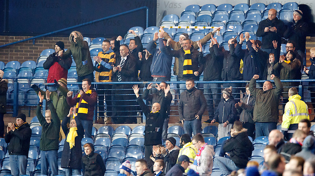 The small band of Alloa fans celebrate at full time