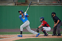 Myrtle Beach Pelicans Kevonte Mitchell (25) at bat in front of catcher Jakson Reetz and umpire Josh Gilreath during a Carolina League game against the Potomac Nationals on August 14, 2019 at Northwest Federal Field at Pfitzner Stadium in Woodbridge, Virginia.  Potomac defeated Myrtle Beach 7-0.  (Mike Janes/Four Seam Images)