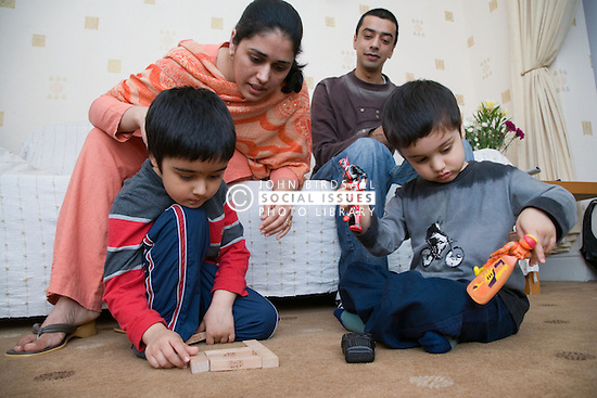 Young family playing together at home,