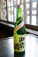 "Bottle of ""Gozenshu"" sake (Tsuji Honten's best known brand). Tsuji Honten Sake, Katsuyama town, Okayama Prefecture, Japan, January 31, 2014. Tsuji Honten was founded in 1804 and has been at the cultural centre of the town of Katsuyama for over two centuries. 34-year-old Tsuji Soichiro is the 7th generation brewery owner. His elder sister, Tsuji Maiko, is the ""toji"" master brewer."