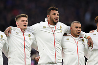 Owen Farrell, Courtney Lawes and Jonathan Joseph of England sing the national anthem. Natwest 6 Nations match between England and Wales on February 10, 2018 at Twickenham Stadium in London, England. Photo by: Patrick Khachfe / Onside Images