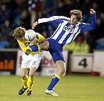 Murray Davidson feels the full force of a Borja Perez tackle.