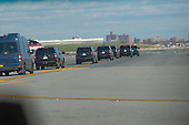 President-elect Trump's motorcade travels along the tarmac at Laguardia Airport as Mr. Trump departs for a series of visits to Indianapolis and Cincinnati, in New York, NY, USA on December 1, 2016. <br /> Credit: Albin Lohr-Jones / Pool via CNP